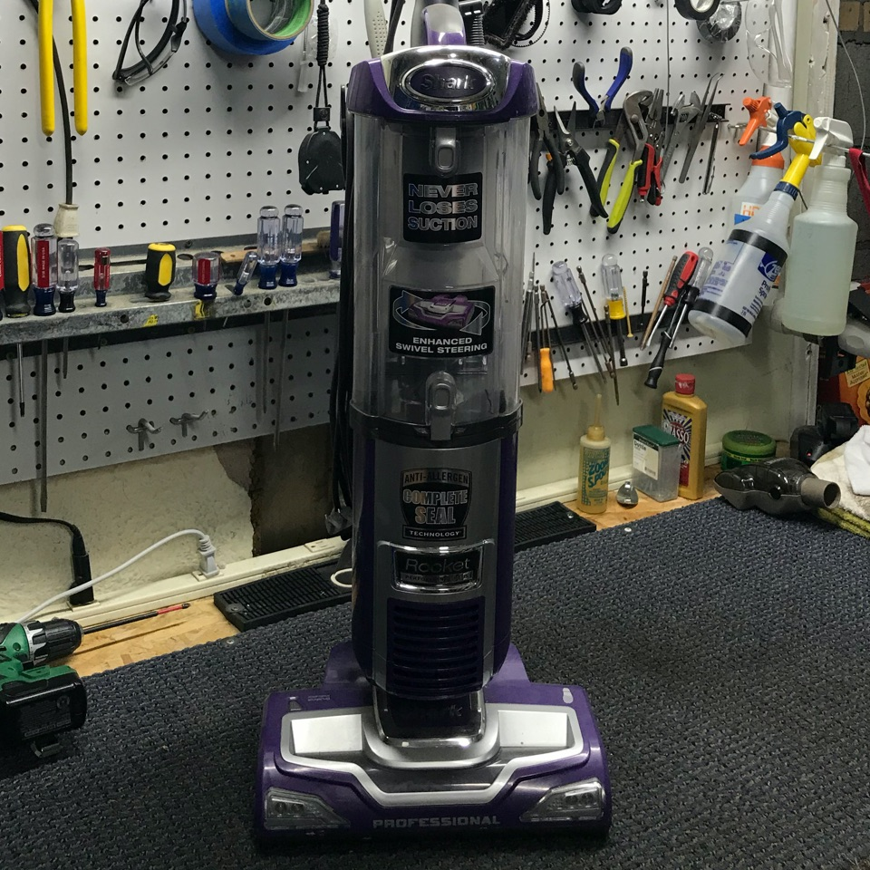 Shark vacuum repair on repair table